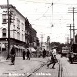 Looking north up Simcoe Street at Four Corners, c. 1920