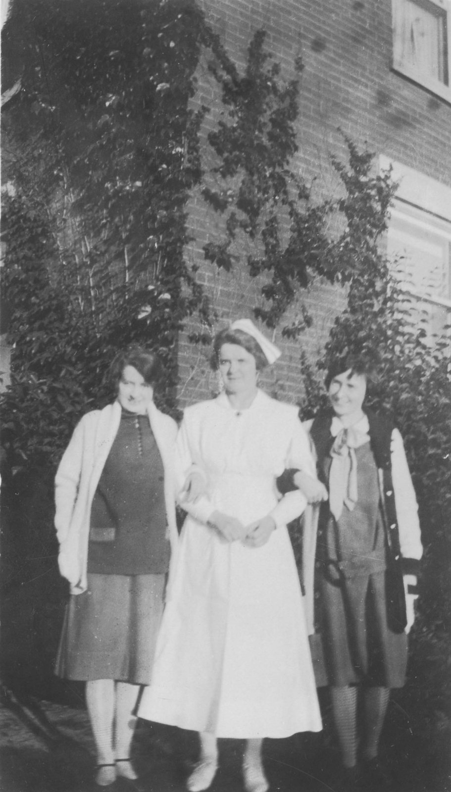 Night Supervisor with Students, c. 1920